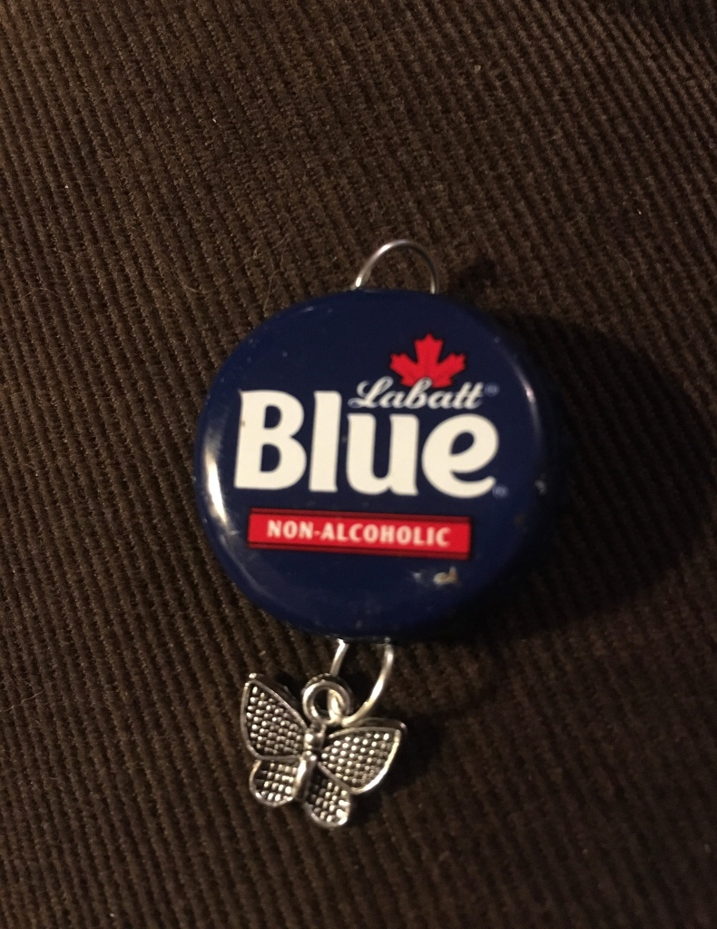 Labatt Blue NA with butterfly charm