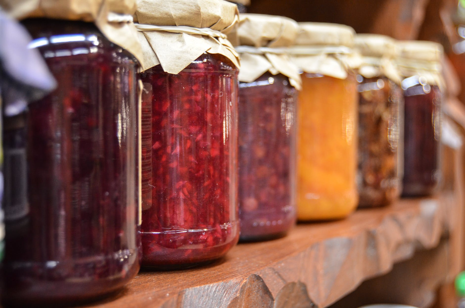 a row of homemade jams and jellies